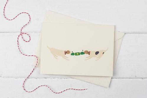 Christmas Russells pulling cracker- Christmas greetings card