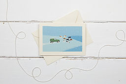Landrover defender and cows in the snow Christmas card