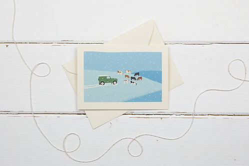 Landrover and cows- Country 4x4 in green out in the snow- Christmas card