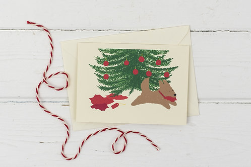 Naughty brown dog under Christmas tree- Christmas greetings card