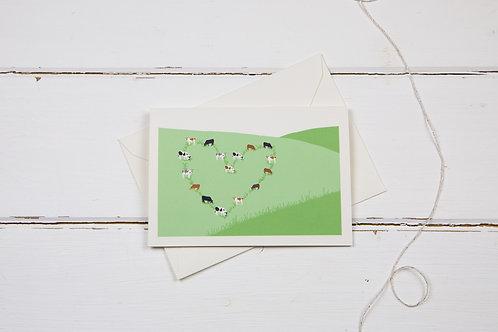 Cows on the hillside love card- cow heart greetings card
