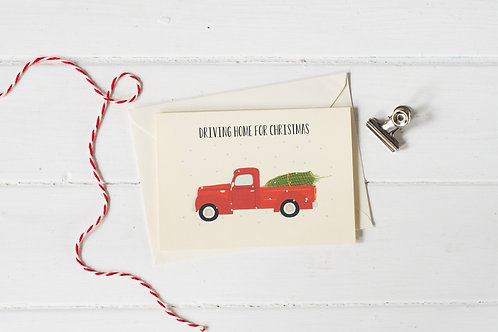 Classic pick up truck in red with Christmas tree- greetings card