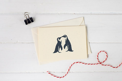 Penguins kissing in the snow- Christmas greetings card