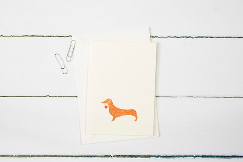 sausage dog with a single red rose greetings card