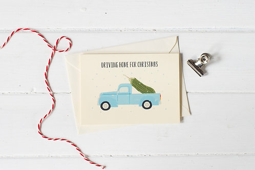 Classic pick up truck in blue with Christmas tree- greetings card