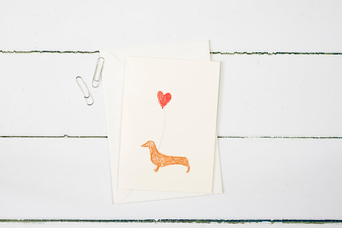 Sausage dog with a heart balloon greetings card