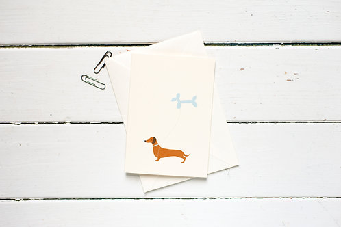 Little sausage dog with a balloon greetings card