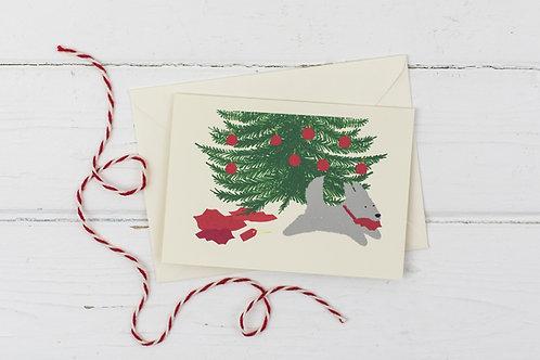 Naughty grey dog under Christmas tree- Christmas greetings card