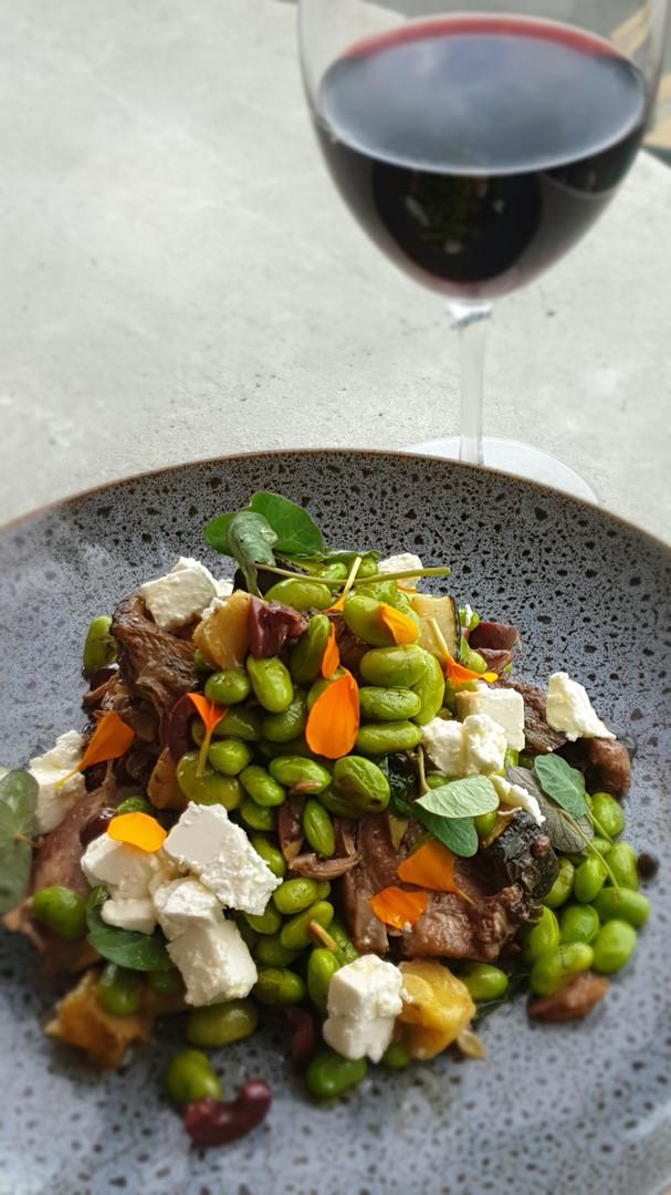 Slow cooked lamb shoulder, bean medley, feta