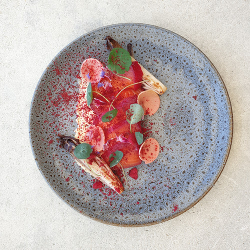 House cured salmon, charred endive, pickled watermelon radishes, fried capers, nasturtium leaves, dehydrated raspberry dust, lime cream cheese