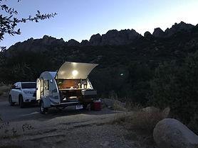 Camper kitchen hatch shown at night