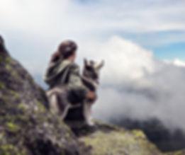 Woman and dog on mountain.jpg