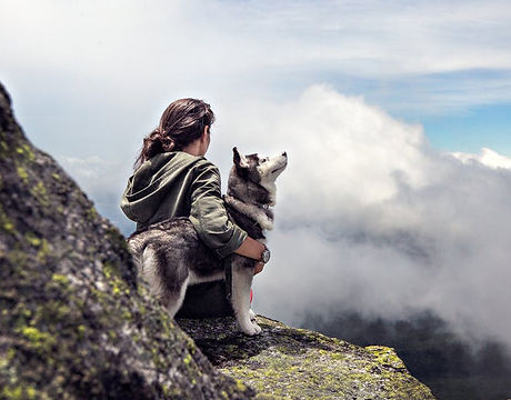 Woman and dog on mountain.jpg