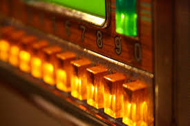 old fashioned juke box, golds and greens, push buttons
