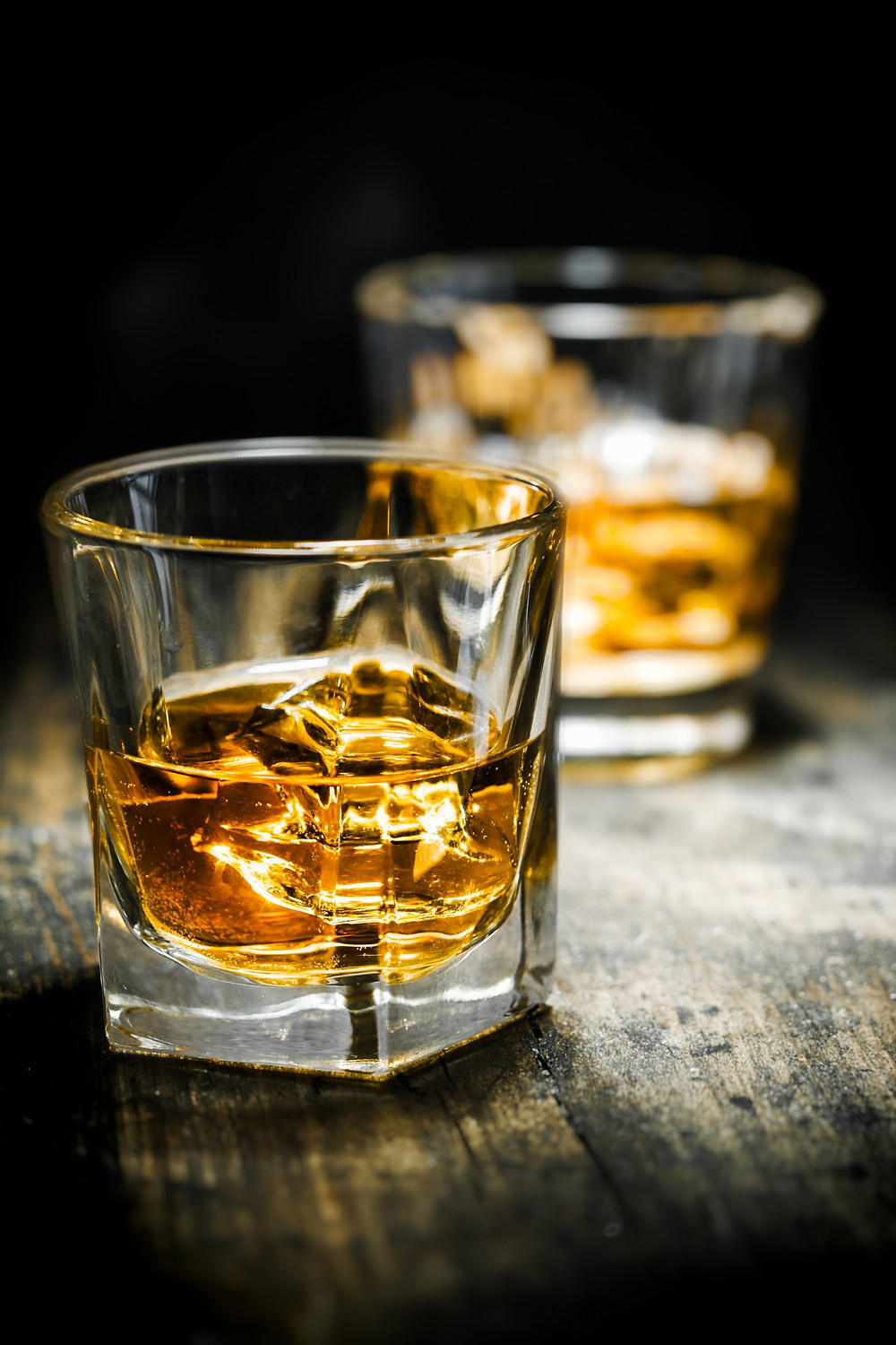 Two glasses of scotch on the rocks