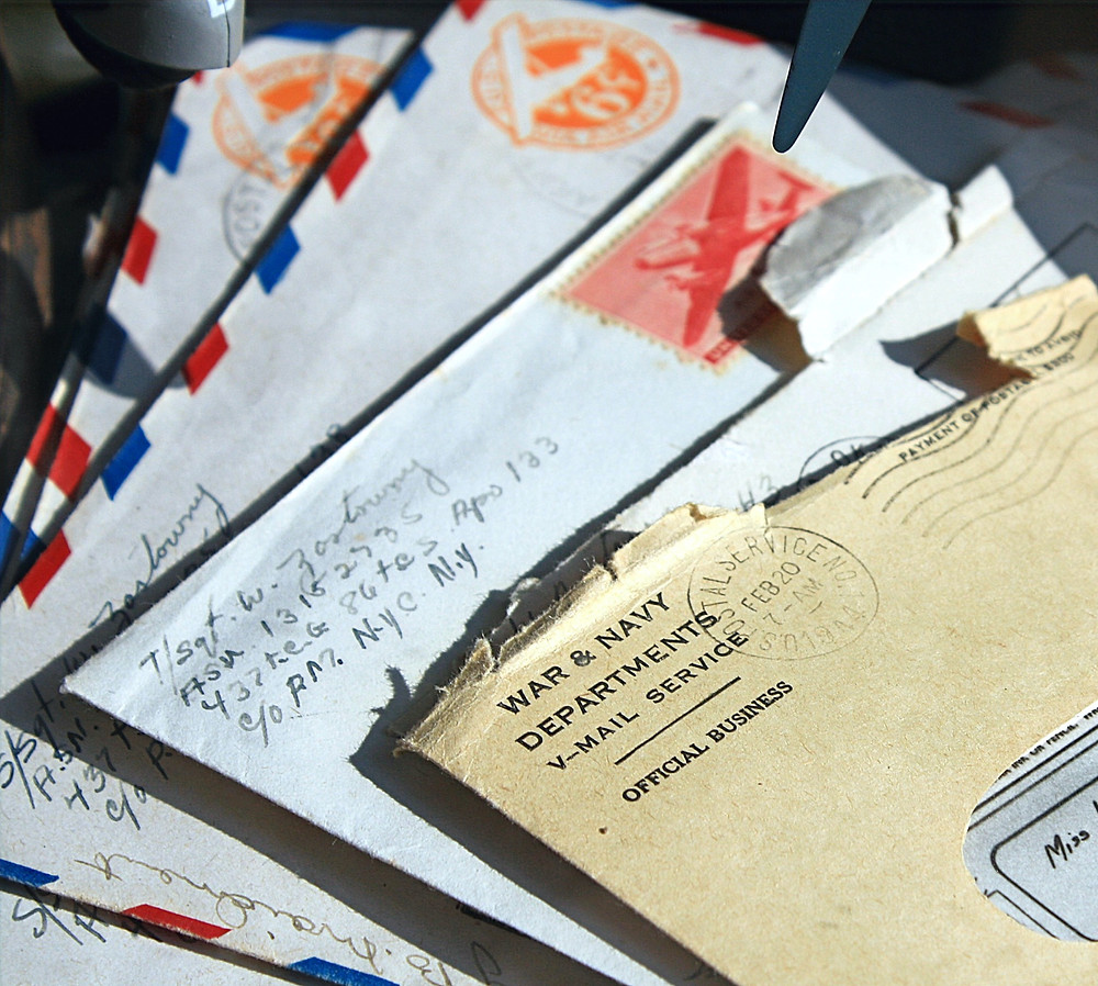 five opened evelopes showing addresses and stamps from WWII