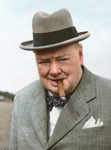 Picture of Winston Churchill in a gray suit, smoking a cigar