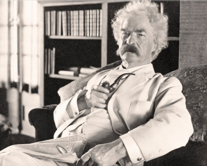 Picture of Mark Twain in a white suit