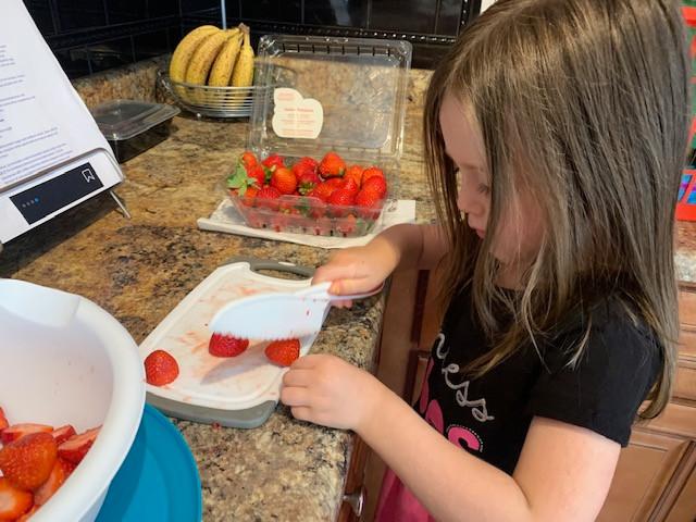 Lu cutting strawberries
