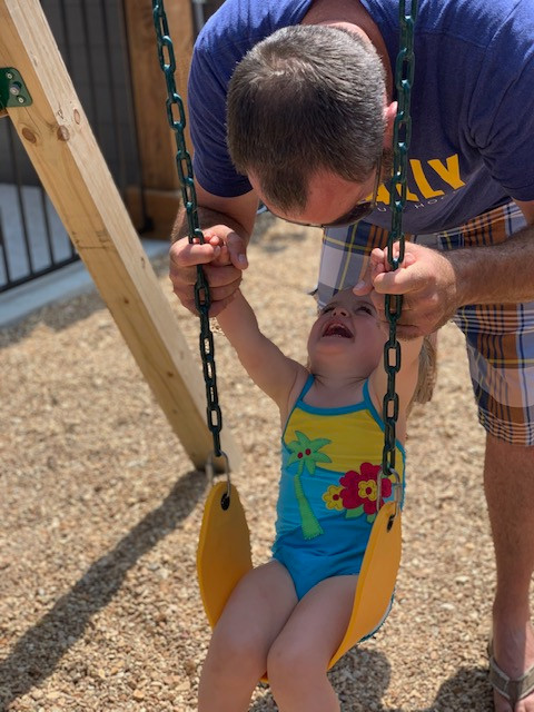 Charli and dad swinging