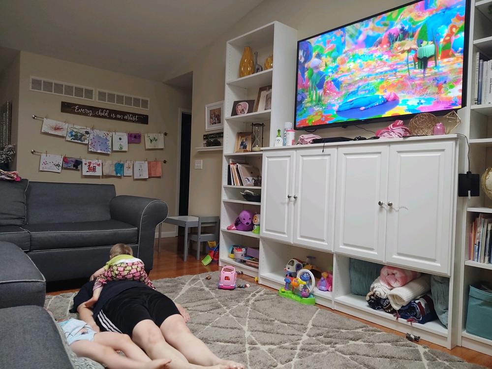 Jill, Charli, and Lu meditating with Cosmic Kids Yoga