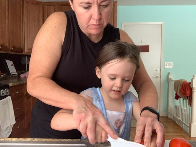 Teaching Lu how to use a knife