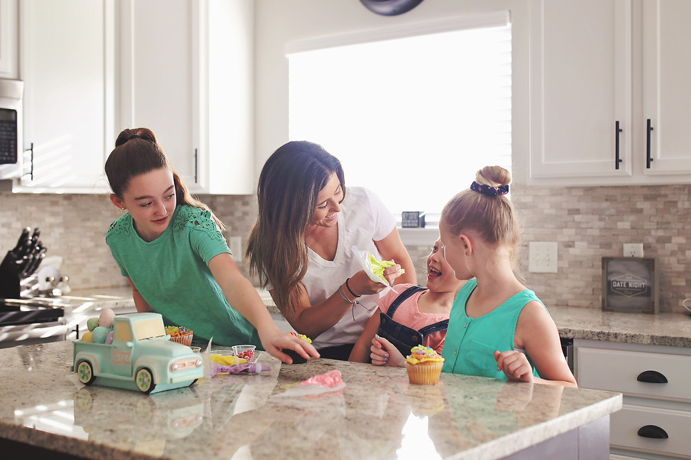 Mom tries to put icing on her daughters nose