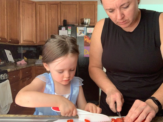 Mom and daughter making salsa