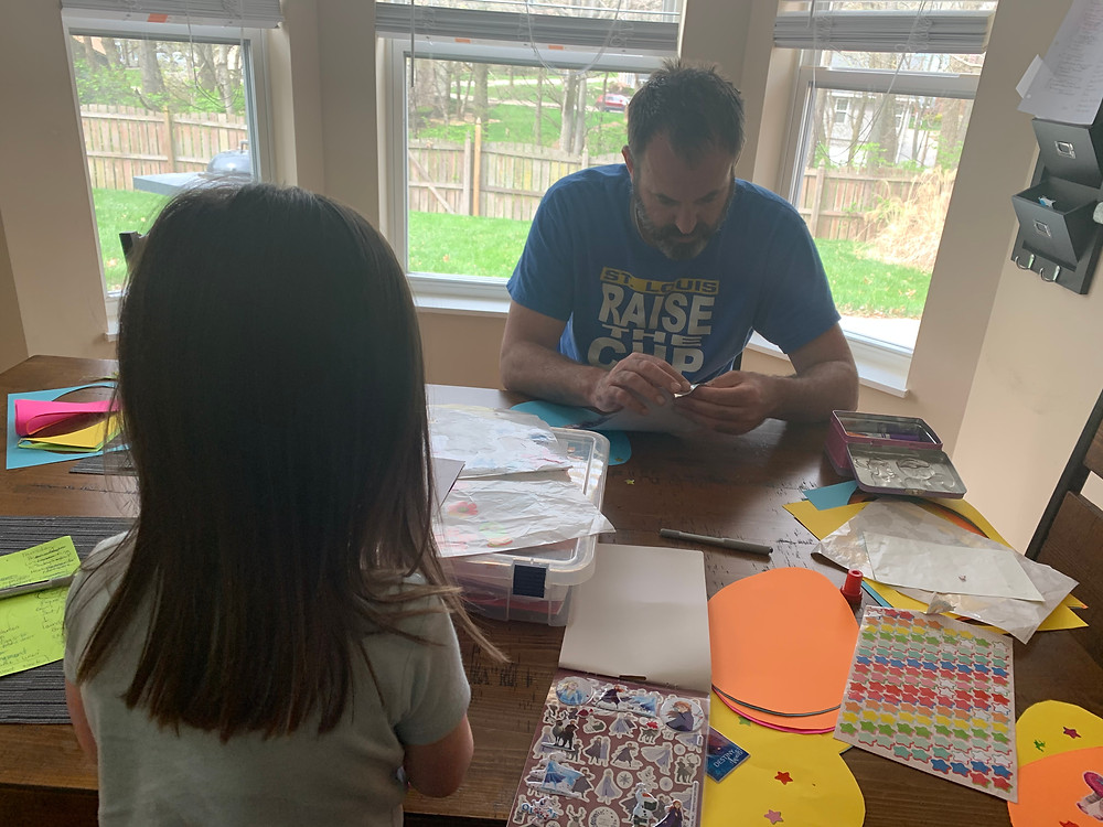 Father and daughter making arts and crafts