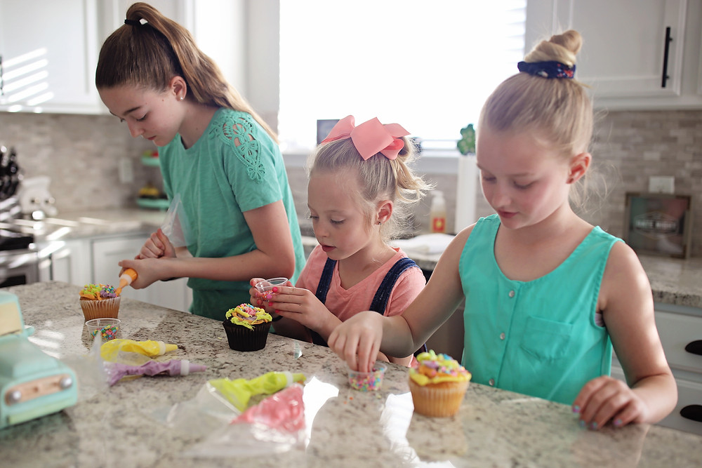 Sisters decorating cupcakes from Sweetology