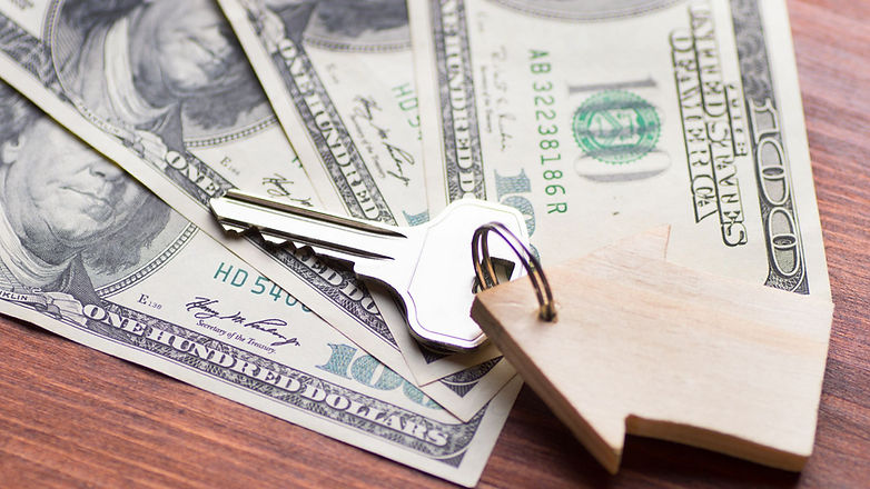 small-model-wooden-house-and-keys-on-one-hundred-dollar-bills-on-wooden-background-1166325074-3e541e