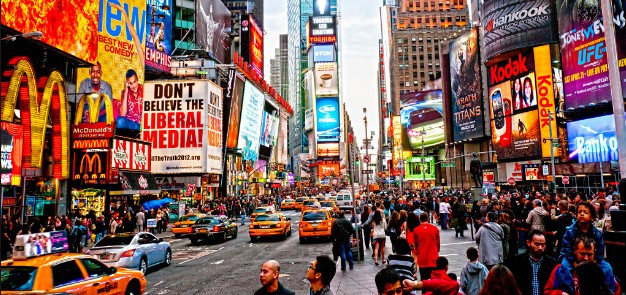 People, signs, and cars in Time Square, NY
