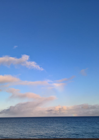 Kaanapali clouds and rainbow