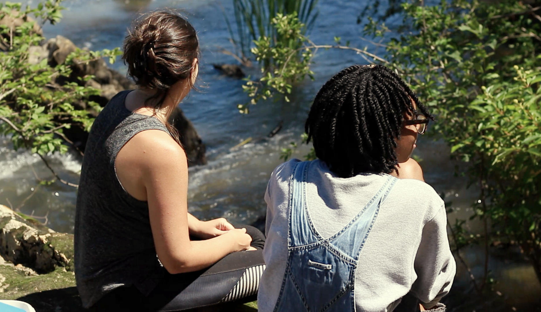 Geology professor Holly Peterson and Blue Mind student during class on the Haw River
