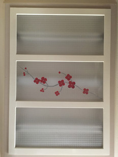 Japanese cherry blossoms design created on kitchen lighting; designed from recycled paani-poori plastic bags
