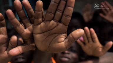 Hands of African kids in Kapepa School, Zambia, Africa