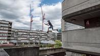 Freerunner jumping over a gap in London, UK