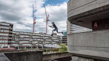 Freerunner jumping over a gap in London, UK