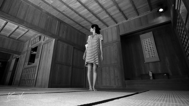 Girl in traditional Japanese house at Expo Park, Okinawa, Japan