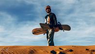 Sandboarder in the Sahara Desert, Morocco