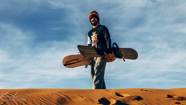 Sandboarder in the Sahara Desert, Morocco
