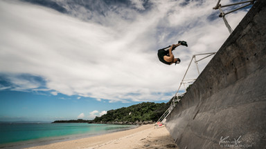 Freerunner performing a huge front flip in Okinawa, Japan