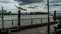 Freerunner doing daring stunts in Greenwich, London, UK