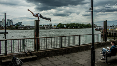 Freerunner doing daring stunts in Greenwich, London, UK