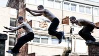 Freerunner doing an arm jump in London, UK