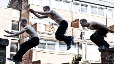Freerunner doing an arm jump in London, UK