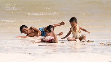 Kids playing on Bulabog Beach, Boracay Island, Philippines