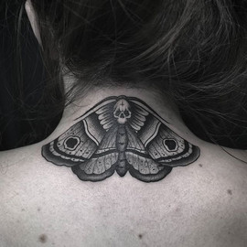 • #moth from my flash on Laura's neck. M