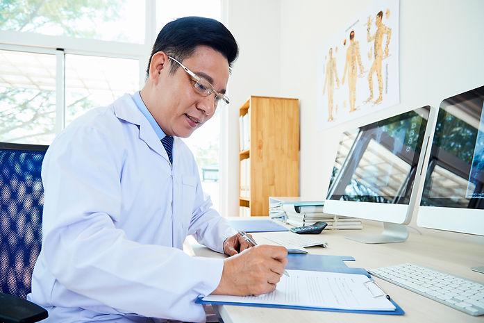 doctor-doing-paper-work-7CXV67B.jpg