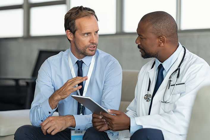 doctor-in-conversation-with-pharmaceutical-represe-Z4V8HAN.jpg